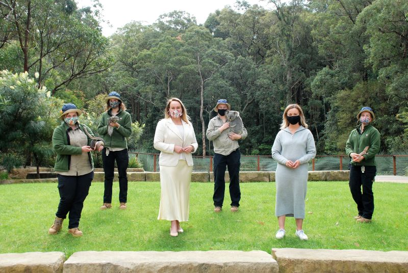 Lord Mayor Nuatali Nelmes and Cr Peta Winney-Baartz with Blackbutt staff members (L-R) Beth Woodhouse with Romeo the snake, Abbey Johnston with Carla the tawny frogmouth, Jemma Gosper with Kirra the koala and Abbie Ferris with Frida the frilled-neck lizard.
