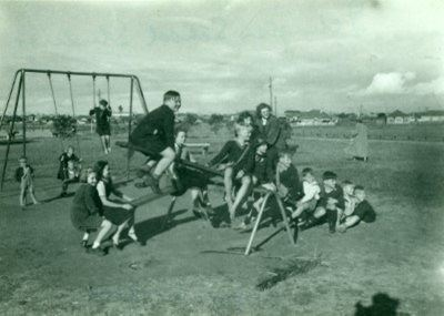 Several children on a seesaw at Islington Park