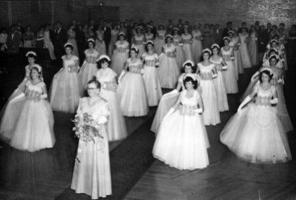 Women in gowns posing in unison at Debutante Ball Newcastle