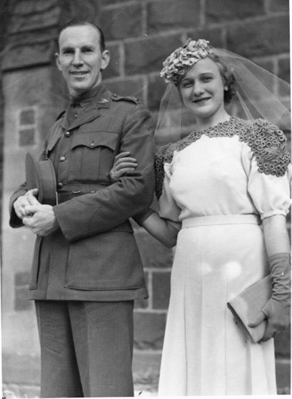 Major and Mrs. Ken Stair on dressed for a wedding